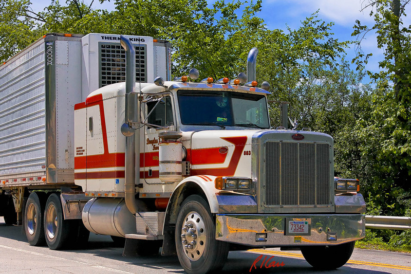 Peterbilt semi-tractor pulls refrigerated trailer. Groton, Massachusetts, 2007.