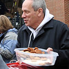 Larry Lucchino appeases the fans with cookies.