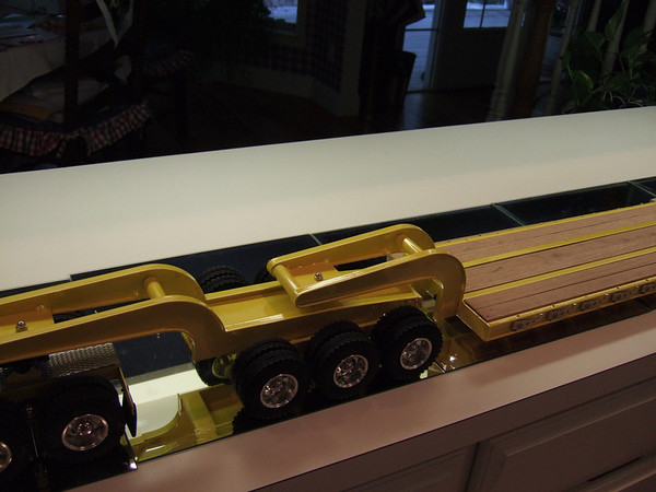 The gooseneck mounted to the front of the deck unit attaches to the 3-axle Jeep.