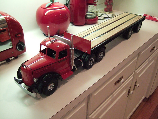 Flatbed Trailer, spread axle version with tool boxes or tarp boxes between the axles.  The undercarriage is detailed and modeled after a real flatbed trailer. Loads such as lumber, equipment, etc. can be secured to the tire down brackets.