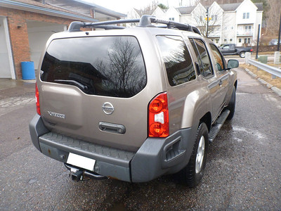 Clear taillights and rear panels.  Note the tow hitch - it comes with all three ball sizes for whatever you want to pull, and this xterra has more than enough power to handle it.