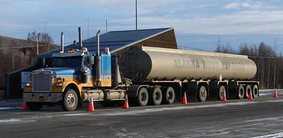 10/15/07 - At the Fox weigh station, an Alaska West Express tanker sits while the driver confers with Weights & Measures officials inside, prior to heading north up the Haul Road.