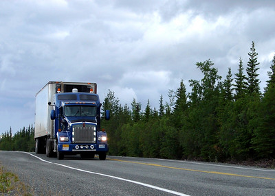 A Carlile semi, shiny Kenworth T800 in front, as it travels along the Tok Cut-Off toward Tok, enroute to the South 48.