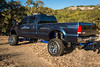 To set his truck apart from others, Chase had a custom 18 inch exhaust tip fabricated for his truck.  You can see it peering out from underneath the bumper, ahead of the giant shackle hanging off his tow hitch.