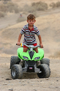 My son, Tyler, ready to tear up the trails on his PowerWheels 4-wheeler.