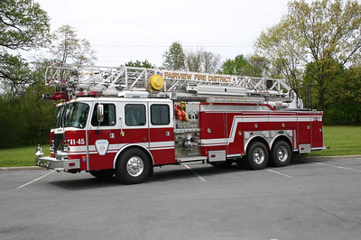 2003 E-One HP100 Aerial Truck with 100' rear mount aerial,  2000 gpm pump, 500 gal. water tank, and variety of ground ladders.