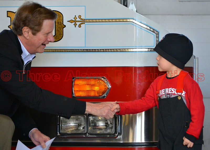 City of Colorado Springs Mayor Steve Bach, congratulating CSFD Honorary Firefighter Caden Rose, during the presentation ceremony of new CSFD Heavy Rescue 17.