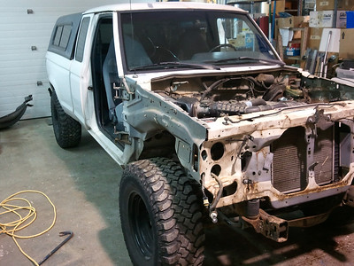 Unbolt doors, fenders, loosen wiring harness and everything from inner fenders, remove battery first.