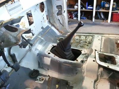 Cab unbolted, steering column removed, shifter bezel taken off.