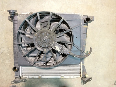 Taurus 2 speed fan I trimmed to fit on the rad.  Have to close in the shroud yet.