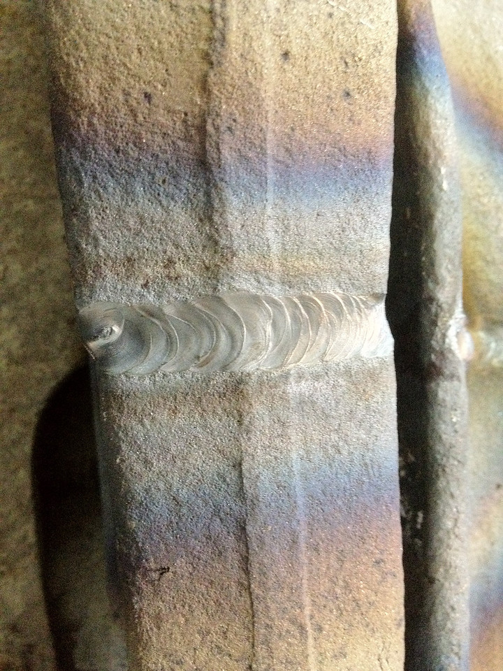 Cranked up the heat on the Tig and re-fused the beam back together.  Great penetration and the sandblasted beams made for contamination free welds.