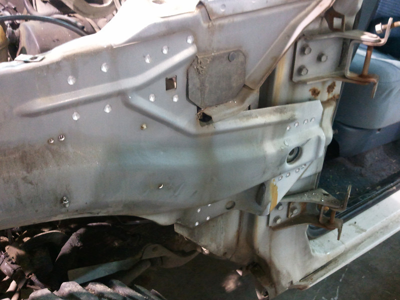 Drill out spot welds holding inner fenders to cab, the pry off with crowbar!