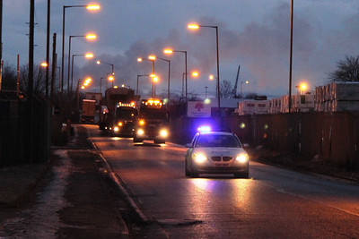 The convoy has just departed from Grangemouth Docks and is about to swap out the lead tractor unit as a result of binding brakes