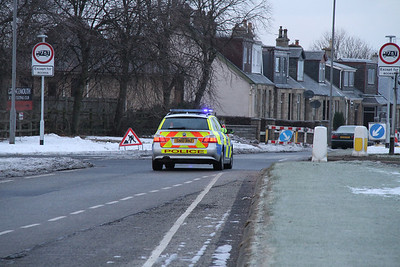 Police wait at the M9 offslip