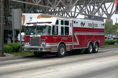 Baltimore City F.D. Rescue 1 in front of the Convention Center during July 2005 at the annual Firehouse Expo.  This is a 2002 PL Custom/Rescue 1 Custom heavy rescue truck with a Spartan chassis.