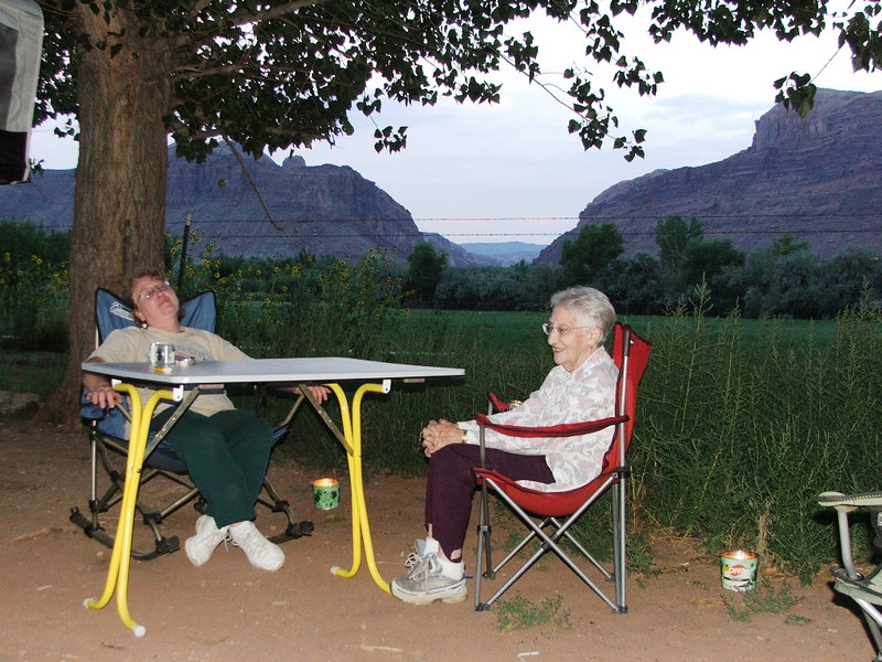 Deb and her mom, Wilma, relaxing at the Slickrock campground after a hard day wheeling.  Colorado River Portal is in the background.