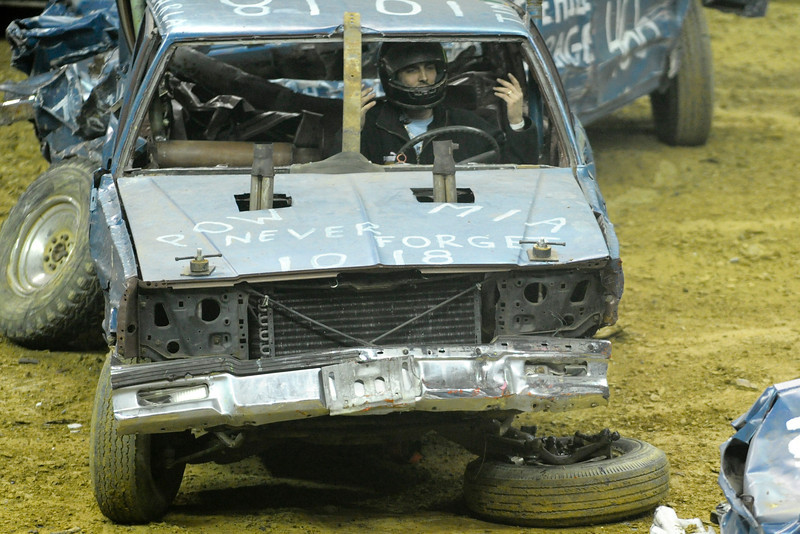A driver in the Demolition derby puts his hands up after his wheel fell of during the Demolition derby.  Monster X Tour at The Bank of Kentucky Center in Highland Heights, Kentucky.