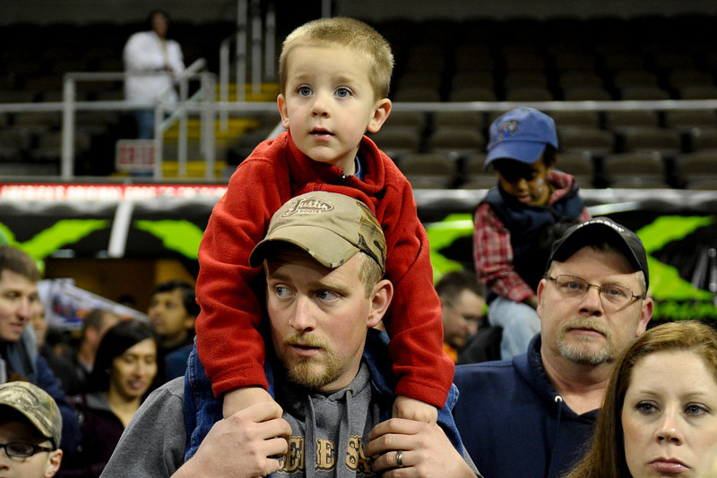 Dads carry there sons on there shoulders to see the big trucks before the show.  Monster X Tour at The Bank of Kentucky Center in Highland Heights, Kentucky.