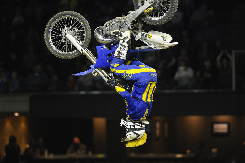 FMX Rider Ed Rossi with a back flip during the Monster X Tour at The Bank of Kentucky Center in Highland Heights, Kentucky.