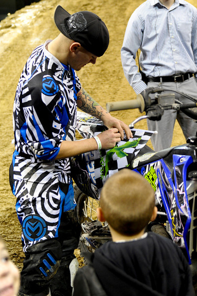 FMX Rider Michael Keeper sign autographs before the show.  Monster X Tour at The Bank of Kentucky Center in Highland Heights, Kentucky.