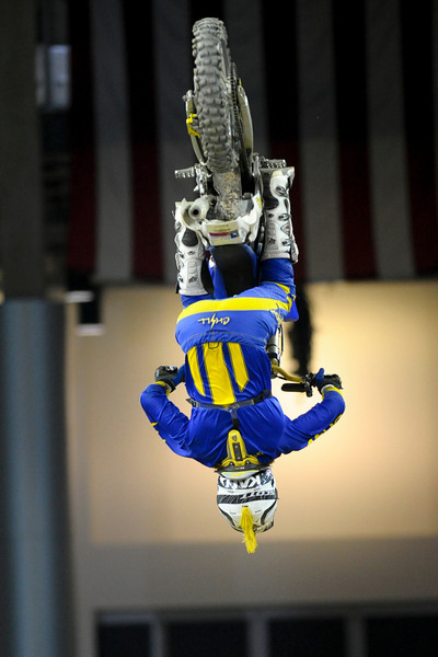 FMX Rider Ed Rossi does a back flip During the show.  Monster X Tour at The Bank of Kentucky Center in Highland Heights, Kentucky.