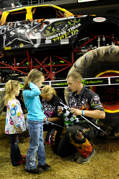 Rock Star with driver Bill Payne and Team Straight Up Racing sign autographs before the show.   Monster X Tour at The Bank of Kentucky Center in Highland Heights, Kentucky.