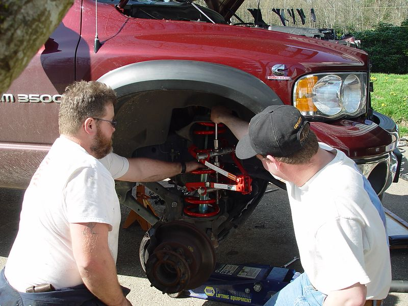 Hoss and Byron, install the new spring using a spring compressor.