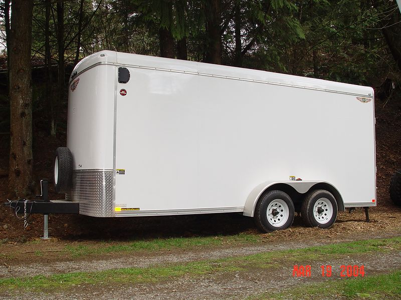 This is a 7 foot wide by 16 foot long trailer built by H&H.  I have it set up inside to haul motorcycles, a small car or a Jeep.