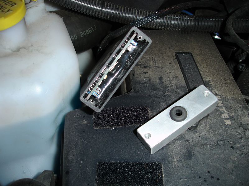 "I am running an ""Edge EZ""  box on my truck.  The box is adjustable by removing the end of the box and moving ""jumpers"" from one position to another.  This is a time consuming process and makes it impossible to change performance of the truck while it is in motion.  My friend Byron, came up with a way to change positions in the box on the fly.  In order to do this I had to machine a different end for the box that allowed for jumpers controlled by in cab switches to be wired into the box."