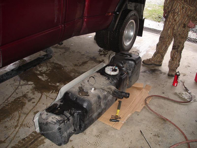 The stock fuel tank vent on the Dodge diesel trucks is way to small.  It takes forever to fill the fuel tank.  Here we have removed the tank in preparation for the installation of a larger fuel tank vent.