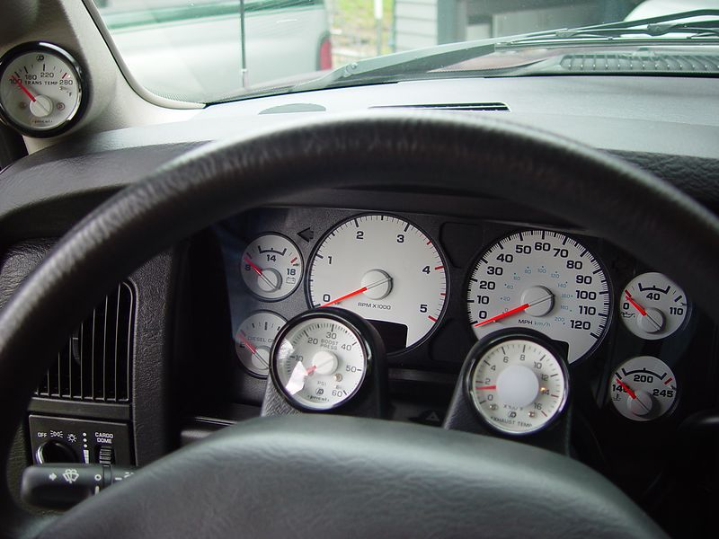 I have just added three new gauges to my truck.  Here's a shot of the stock dash and the new gauges.