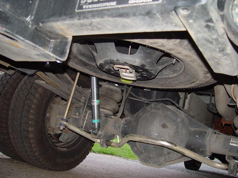 Here I have installed Bilstien shocks and a IPD sway bar on the rear of the truck.  These suspension modifications will make the truck handle much better when hauling the heavy camper and or pulling the loaded trailer.