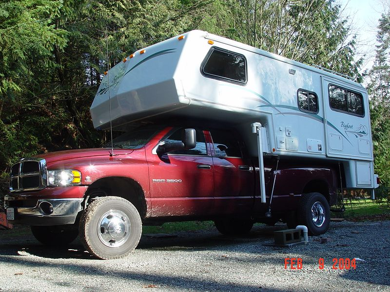 "This is my truck with the ""Big Foot"" 11 foot camper mounted on it.  This is a very nice camper, it has every modern appliance, forced air heat, AC, micro wave, fridge, freezer, TV, generator, full inside and out side shower, dry toilet, gas stove with oven, CD-stereo radio, etc.  The dining area slides out about 18 inch's providing much more interior room when your parked and in camp.  With this camper me and my wife plan to spend many happy hours on the road and in the woods enjoying the life of a wanderer.  I have an enclosed trailer that I will tow behind this rig to haul our motorcycles, that way when we get someplace interesting we can set up camp and ride our bikes to check out the area."