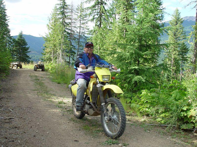 John riding my bike.