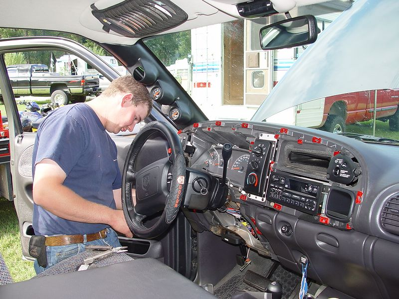 Byron doing the wiring in the cab and finishing the gauge installation.