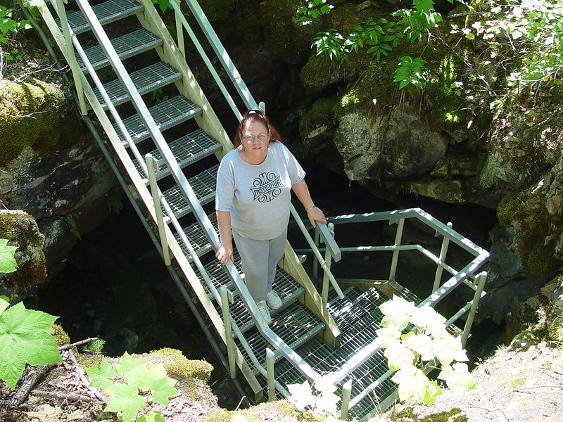 Donna going into the cave.