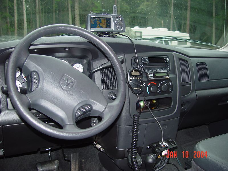 """This is the interior of my truck.  I have had the GPS, in all of my vehicles including my motorcycles, I would be """"lost"""" with out it.  I mounted the 6 disk CD changer on the passenger side of the transmission hump, the controller is mounted just above the heater controls.  The gage with the switch on either side of it controls the pressure in the Ride-Rite rear suspension.  I just installed the CB.  I think I have just about all the gadgets I need at this time, well almost."""