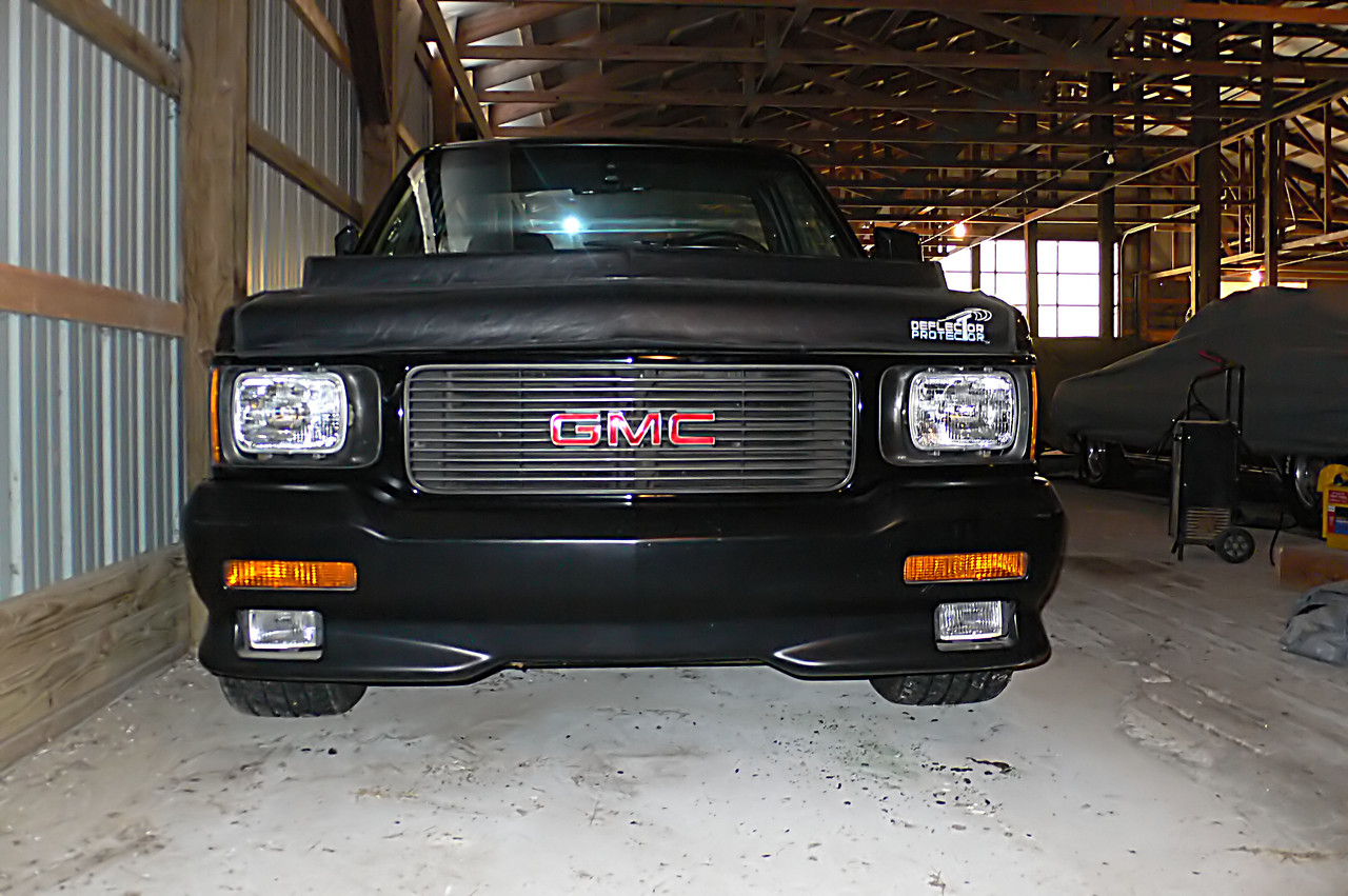 Yes, the bra must go. Notice the crack in the grille at the far left, and top above the GMC logo?