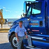 Lee and his new truck provided by Werner Enterprises