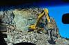 Highway Rockcut, Travel Photo, Ric Evoy Rictographs Images; Big Rigs Moving Rocks