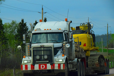 Heavy Equipment Trucking,