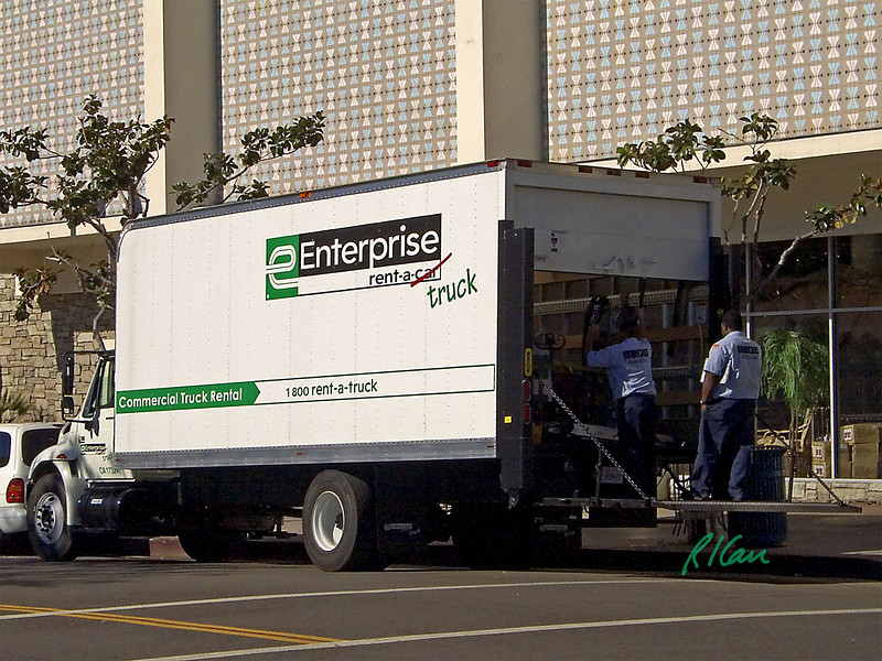 Freight truck: Enterprise rental International straight truck with power lift on rear, making delivery. Los Angeles, CA 2004.