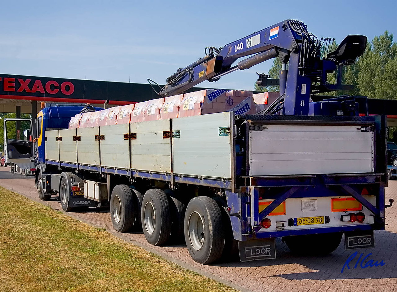 Scania semi truck tractor and Floor trailer with attached crane haul bricks. Holland 2006