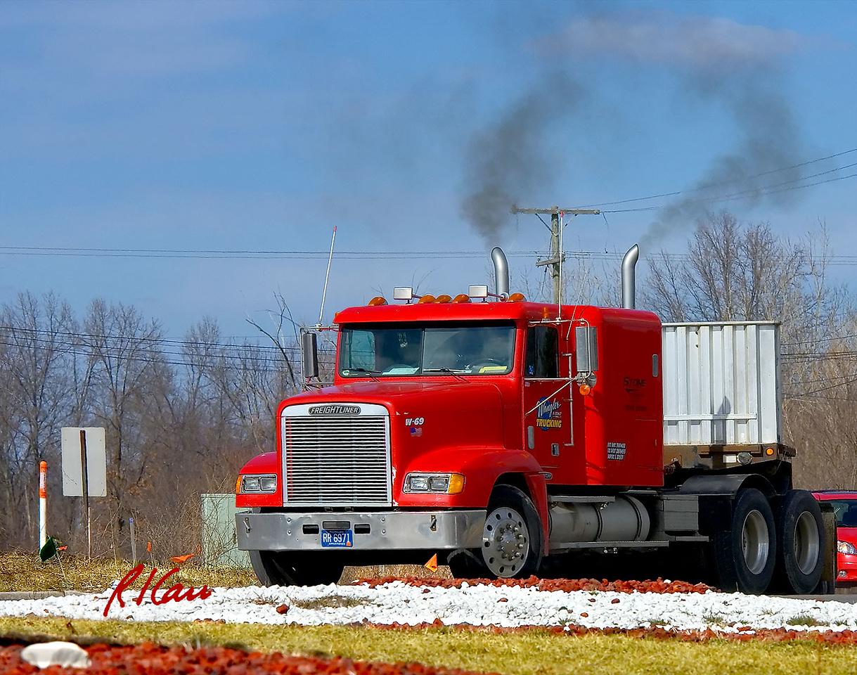 Freightliner semi-tractor and gooseneck semi-trailer. Carpenter Road and Michigan Avenue/US 12