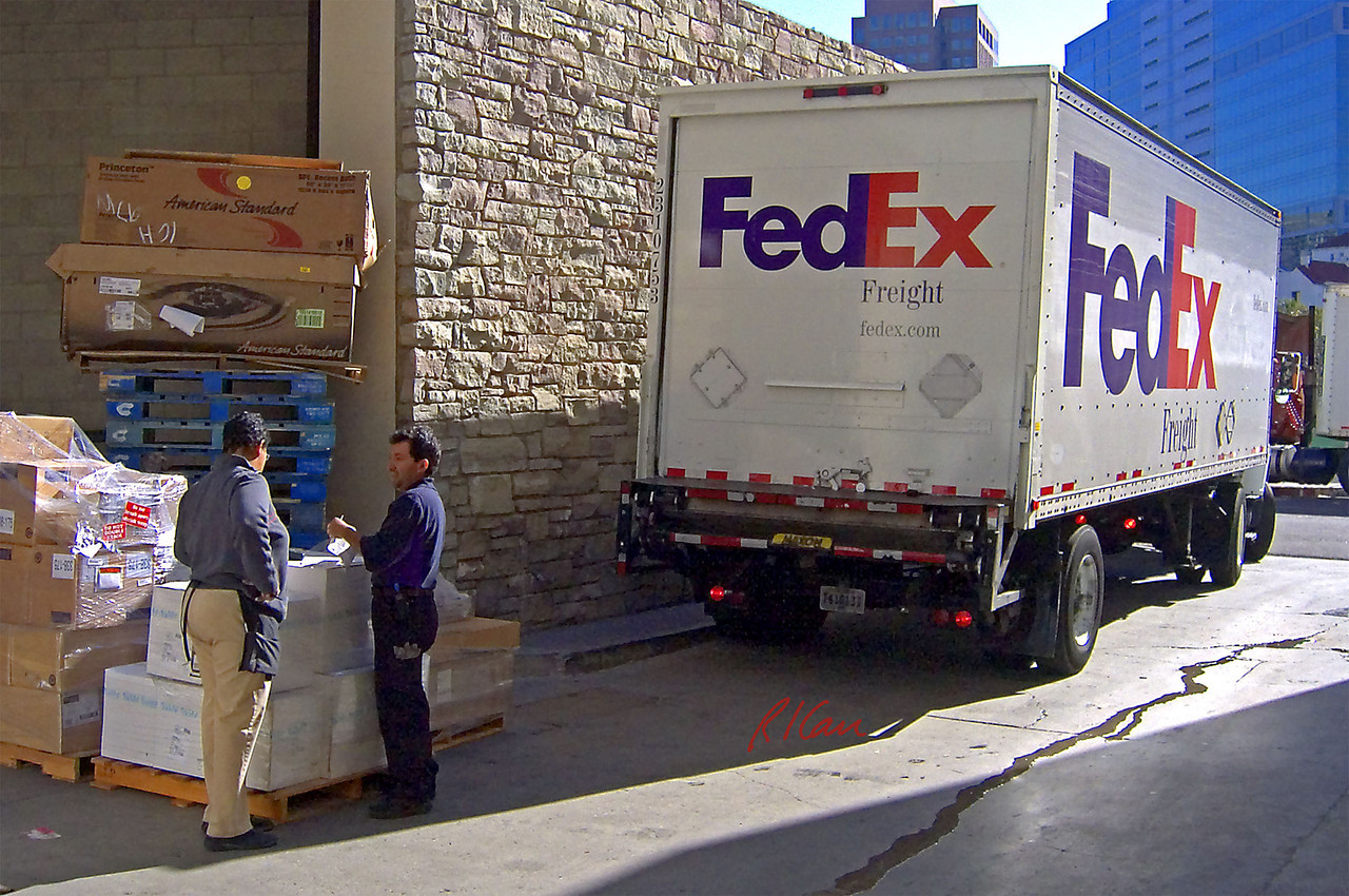 Freight truck: FedEx straight truck with power lift on rear, making delivery. Los Angeles, CA 2004.