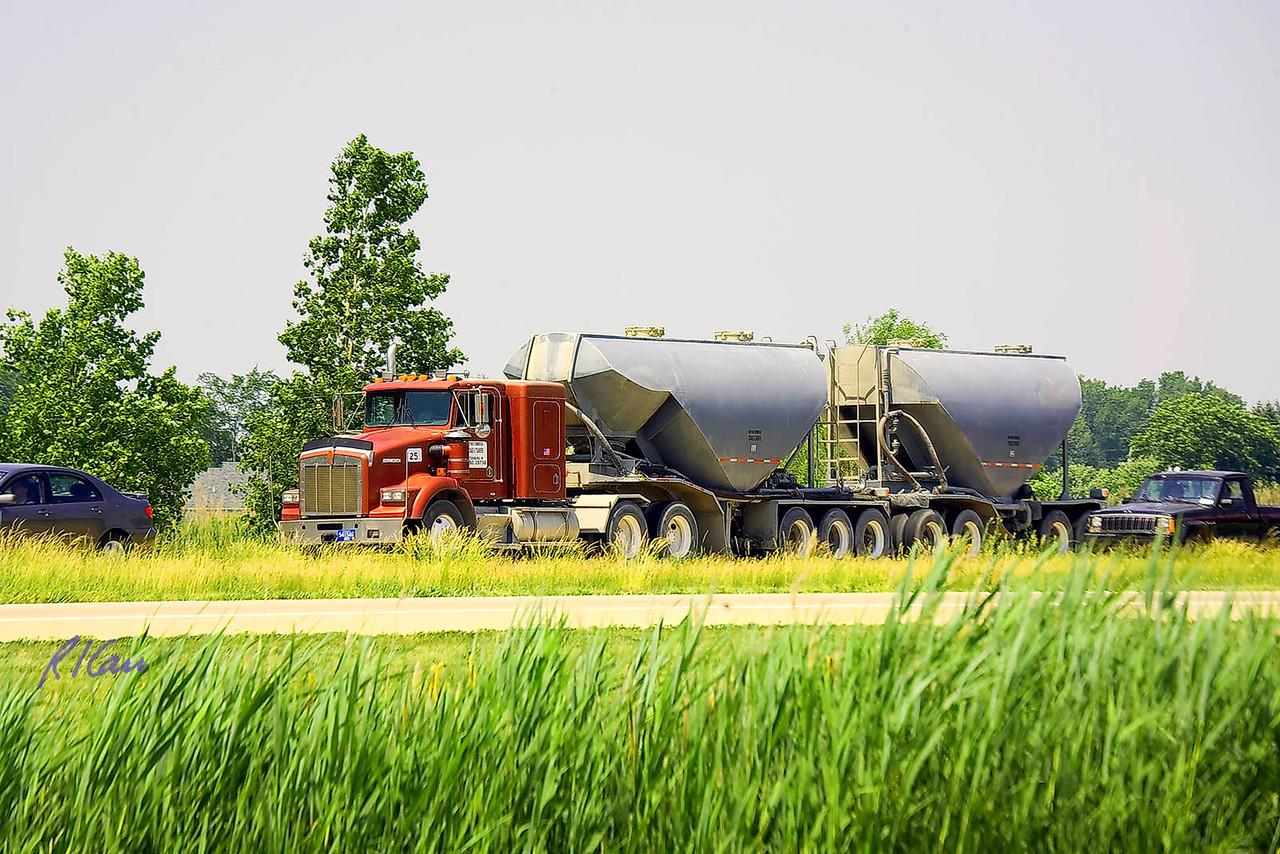 Trucks: Peterbilt truck tractor pulling double bottom dump trailer on US23 south of Ann Arbor, Michigan, June 2006.