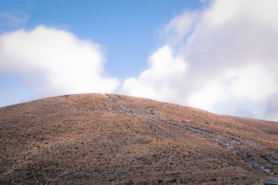 Looking up at the 70+ meter hill that we have to climb, snow mud and slippery clay with a touch of tussock. No worries!