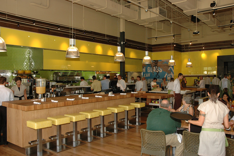 The eight barstool seats provide the best views of the open kitchen.