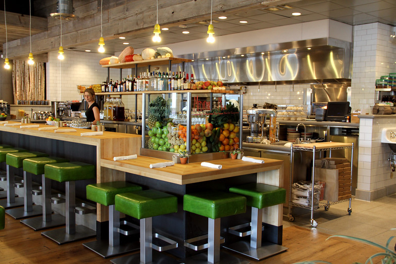 The juice bar of True Food Kitchen is filled with fresh fruits and vegetables