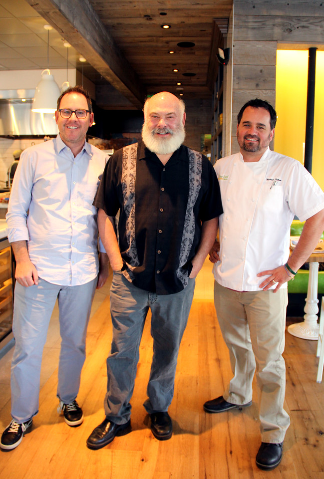 Sam Fox, Dr. Weil, and Michael Stebner pose for a photo during opening weekend of the True Food Kitchen in Denver